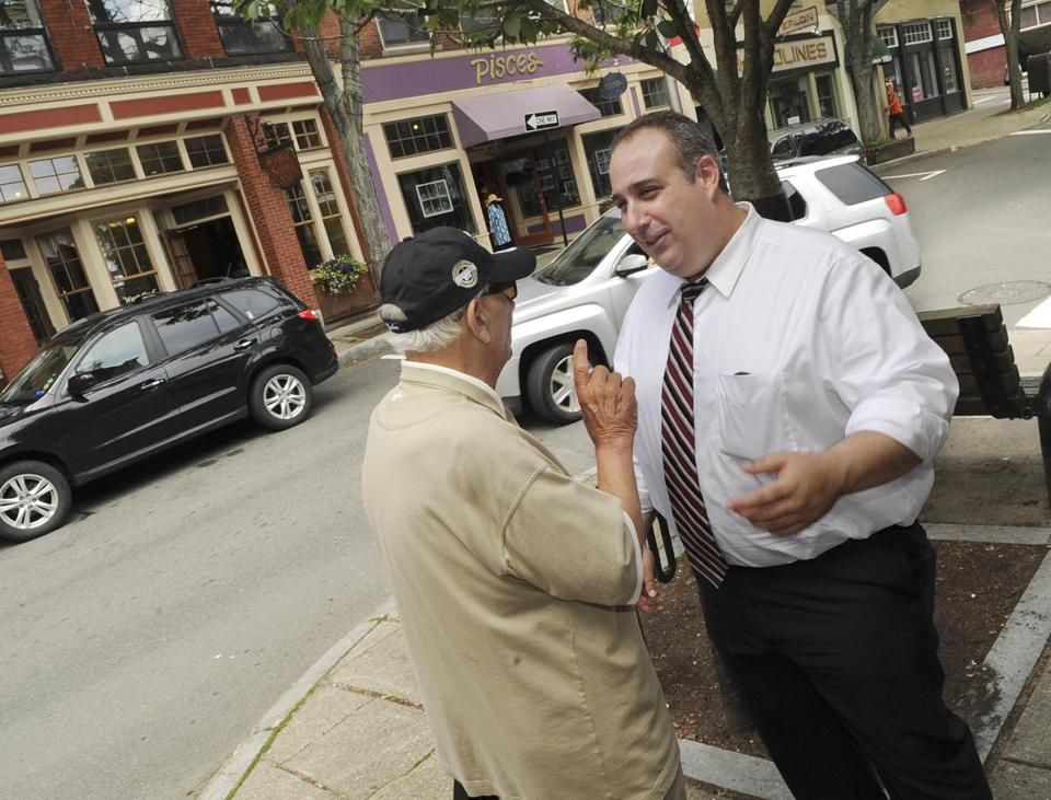 Campanello (right) talked with resident Frank Iacono on Main Street in Gloucester.